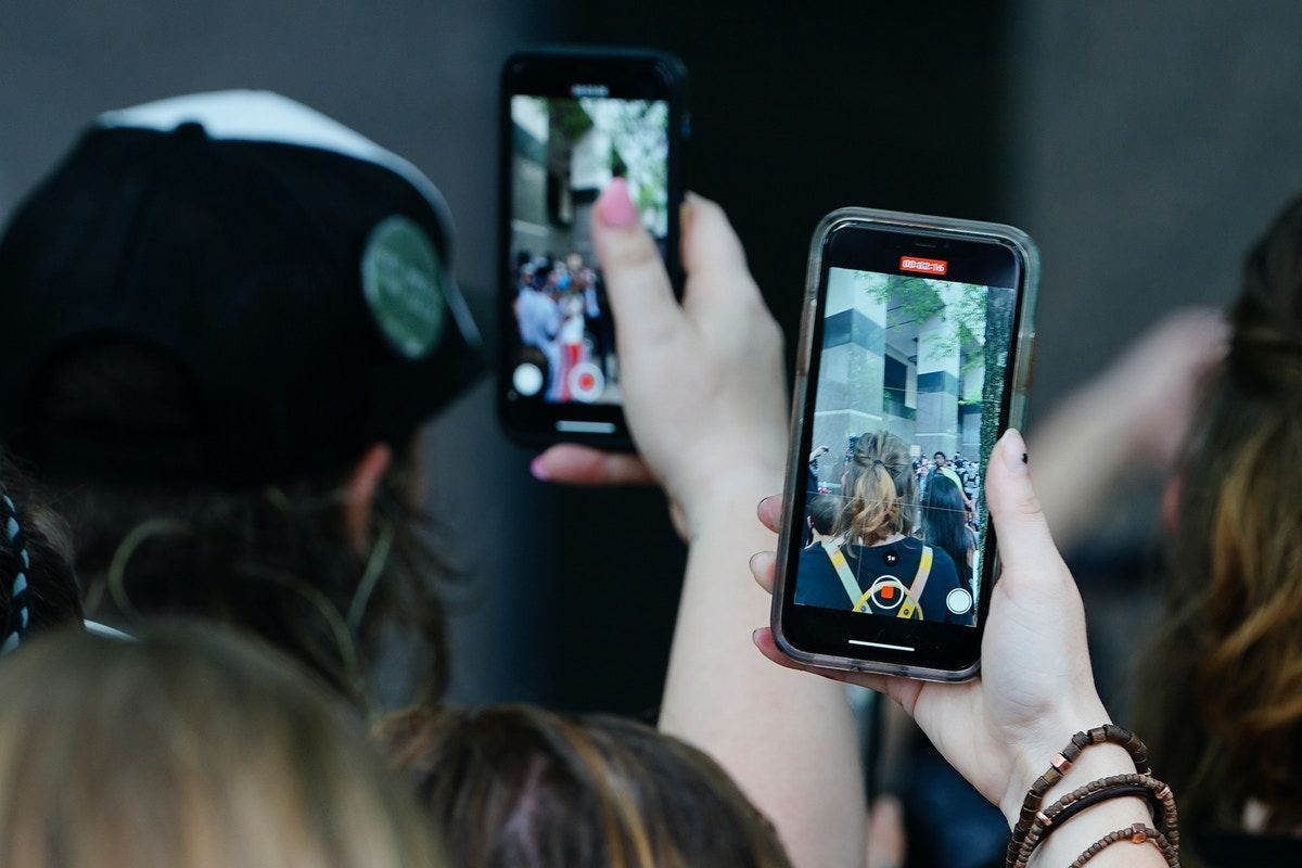 Picture shows people using their phones to film protests