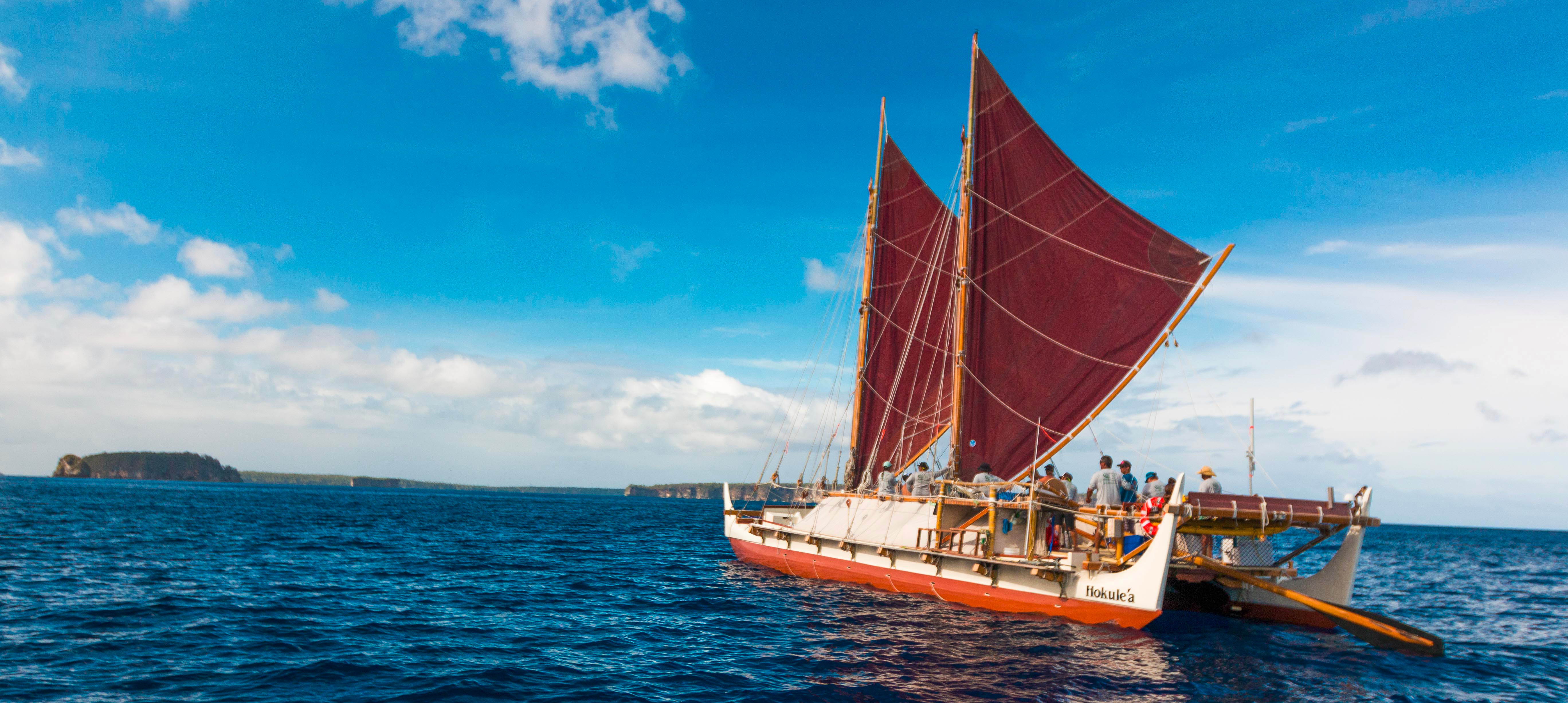 The Hōkūle'a double-hulled voyaging canoe, which since its first launch in 1975, has sailed over 140,000 nautical miles. Courtesy Polynesian Voyaging Society. Photo by ʻŌiwi TV. 2015.