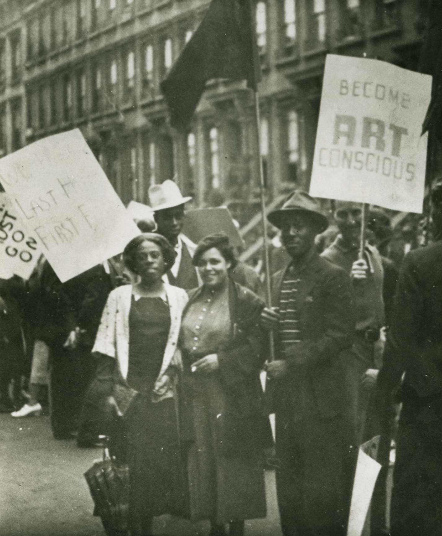 Members of the Harlem Artists Guild picketing with the Works Progress Administration Artists Union to protest cutbacks to WPA programs. Gwendolyn Bennett (center), Norman Lewis (right), and Frederick Perry (wearing the white hat). Harry Henderson Papers,