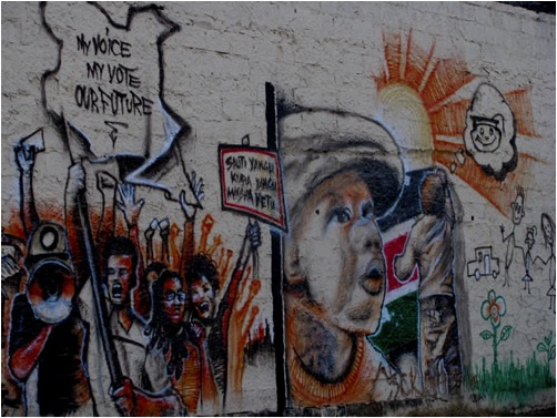 Mural shows people picketing with the text My Voice My Vote our Futures