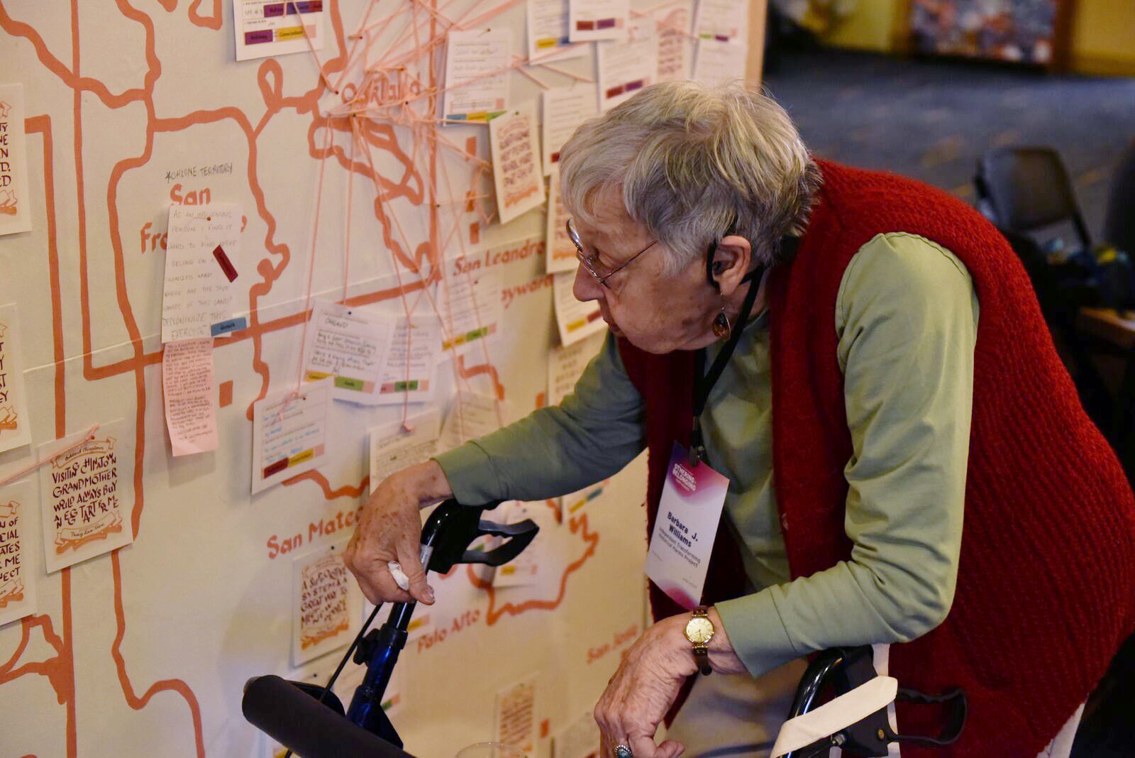 A 2019 Othering & Belonging conference attendee reads through the map of places of belonging created by Haas Institute Artist in Residence Christine Wong Yap and dozens of conference attendees. Photo by Eric Arnold.