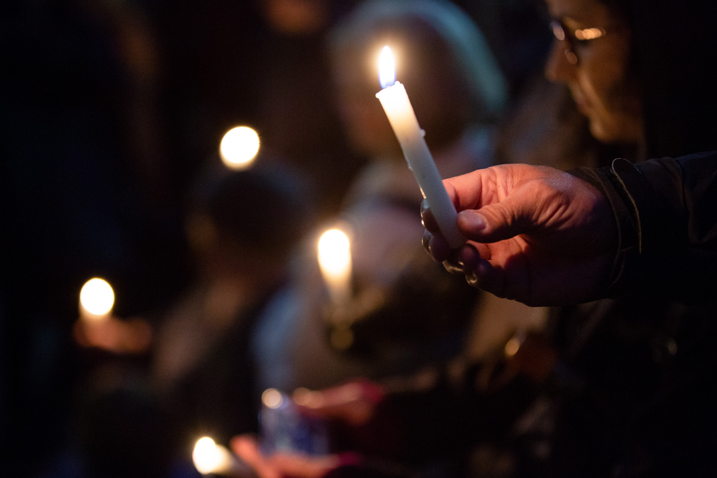 People hold a candlelight vigil for the victims of the Pittsburgh synagogue shooting