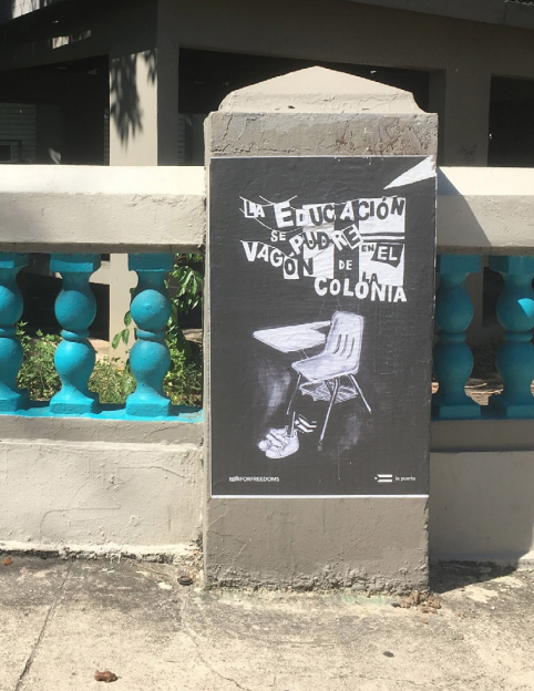 """A poster on the closed Madame Luchetti school in San Juan reads, """"Education rots in the colony's container,"""" in clear reference to the hundreds of dead bodies stored in containers after Hurricane Maria. By the time of this publication, the doors and windo"""