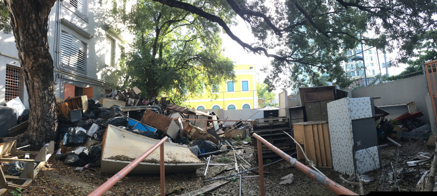 The Dr. Martin Grove Brumbaugh school grounds, where garbage, debris, and broken furniture has accumulated. The school was sold to a firm with ties to real estate development.