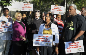 This picture is of. Safe Return members and supporters speak at a press conference about the proposed jail expansion in Contra Costa County in 2012
