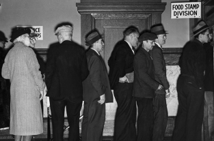 This image is Applicants for food stamps line up before a window in the Food Stamp Division Office in Rochester, New York, the first city the Federal Food Stamp Plan in 1939. Photo Courtesy National Archives and Records Administration.