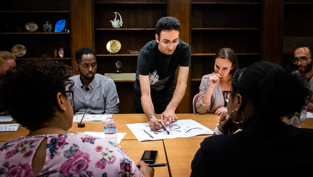 Program fellows during an evening workshop on calligraphy with artist Arash Shirinbab.